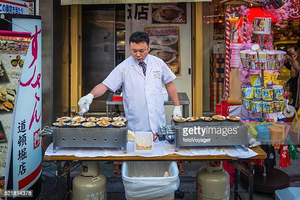 Japon chef grillades de fruits de mer traditionnel collations rue Étal de marché Osaka