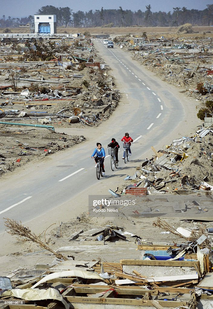 NATORI Japan Children ride bicycles in Natori Miyagi Prefecture on March 29 2011 The area was devastated by a massive tsunami following a magnitude...