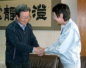 SENDAI Japan Chinese Ambassador to Japan Cheng Yonghua and Sendai Mayor Emiko Okuyama shake hands at the Sendai city offices in Sendai Miyagi...