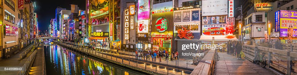 Japan city nightlife neon lights crowds of shoppers Dotonbori Osaka