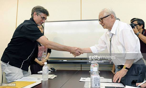 HIROSHIMA Japan Clifton Truman Daniel the eldest grandson of former US President Harry Truman shakes hands with a survivor of the 1945 atomic bombing...