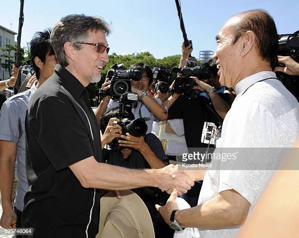 HIROSHIMA Japan Clifton Truman Daniel the eldest grandson of former US President Harry Truman shakes hands with Masahiro Sasaki head of the nonprofit...