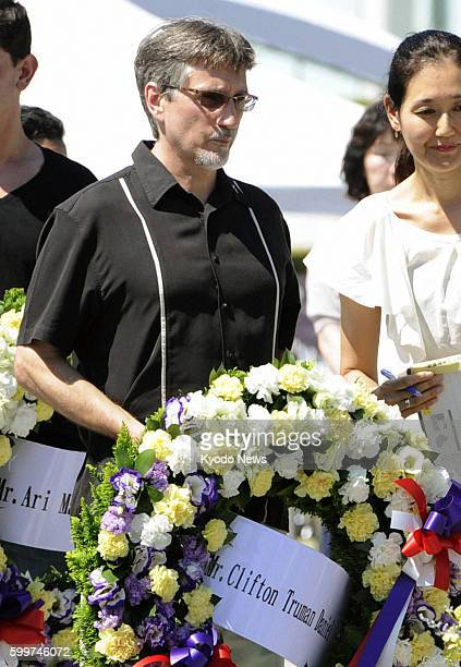HIROSHIMA Japan Clifton Truman Daniel the eldest grandson of former US President Harry Truman offers flowers at the cenotaph for the victims of the...