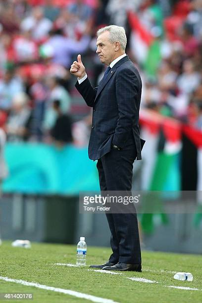 Japan coach Javier Aguirre gives the thumbs up during the 2015 Asian Cup match between Japan and Palestine at Hunter Stadium on January 12 2015 in...