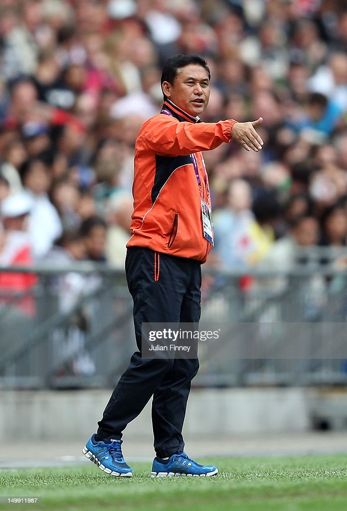 Japan coach, Norio Sasaki gives instructions during the Women's Football Semi Final match between France and Japan on Day 10 of the London 2012 Olympic Games at Wembley Stadium on August 6, 2012 in London, England.