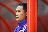 Japan coach Norio Sasaki looks on during the FIFA Women's World Cup 2015 Round of 16 match between Japan and Netherlands at the BC Place Stadium on...