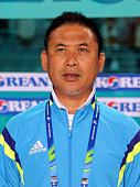 Japan coach Norio Sasaki poses during the Football Womens Group B match between Chinese Taipei and Japan during day three of the 2014 Asian Games at...