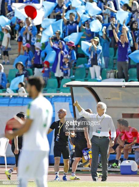 Japan coach Vahid Halilhodzic gives instructions to his players during a World Cup qualifier against Iraq in Tehran Iran on June 13 2017 ==Kyodo