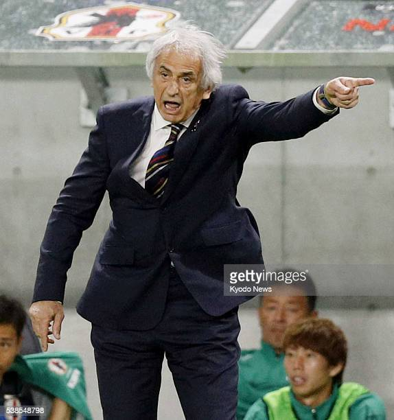 Japan coach Vahid Halilhodzic issues instructions to his players during the second half of a Kirin Cup match against BosniaHerzegovina at Suita...