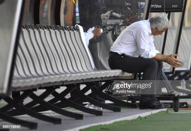 Japan coach Vahid Halilhodzic sits alone on the bench after a 11 draw with Iraq in a World Cup qualifier in Tehran on June 13 2017 ==Kyodo
