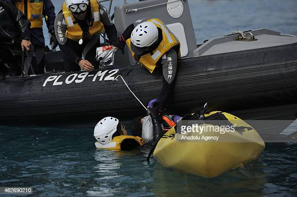 Japan coast guard team intervene a protestor as people use motor boats and kayaks to defy Japan Coast Guard in the Oura Bay to protest against the...