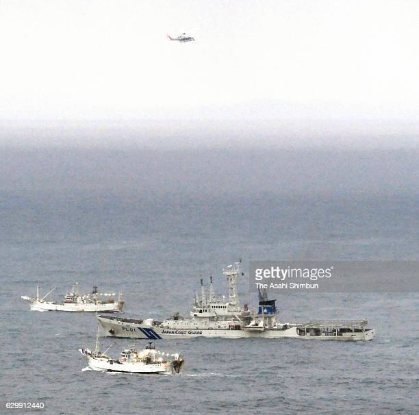 A Japan Coast Guard vessel and fish boat in searching operation on December 15 2016 in Matsue Shimane Japan Eight crew members of crab fishing boat...
