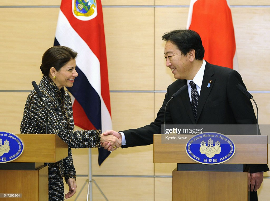 TOKYO Japan Costa Rican President Laura Chinchilla and Japanese Prime Minister Yoshihiko Noda shake hands after their press conference in Tokyo on...