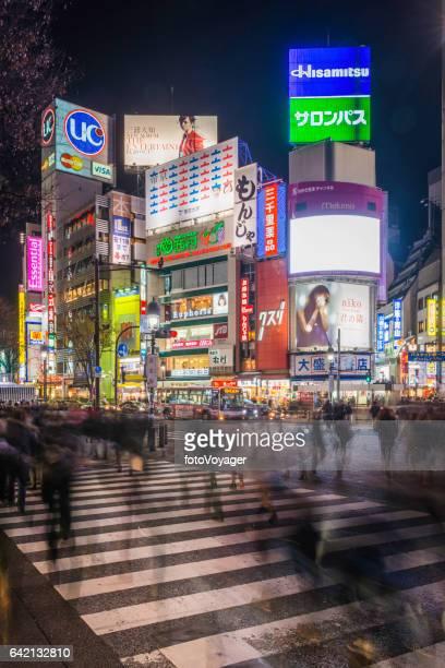 Japan crowds people neon Shibuya Crossing futuristic night city Tokyo