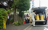 TOKYO Japan Drums containing bottles with radioactive substances are loaded into a vehicle beside a house in Tokyo's Setagaya Ward on Oct 14 2011...