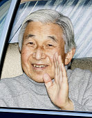 TOKYO Japan Emperor Akihito waves from a car as he arrives at the Imperial Palace in Tokyo after being released from the University of Tokyo Hospital...