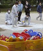 FUKUSHIMA Japan Employees of the Japan Atomic Energy Agency dig at a playground of a kindergarten attached to Fukushima University in Fukushima City...