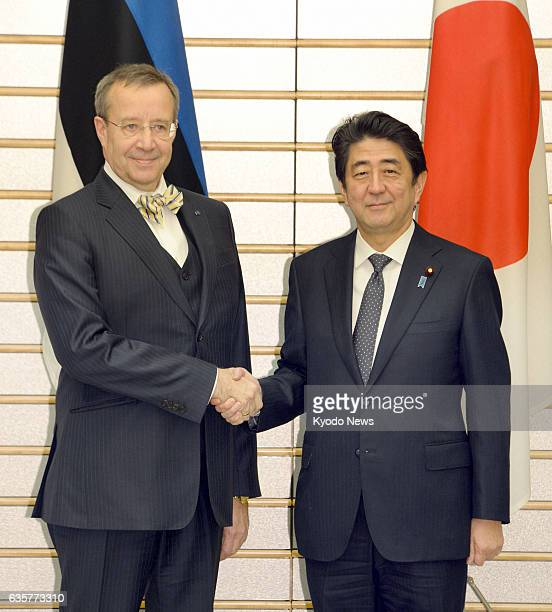 TOKYO Japan Estonian President Toomas Hendrik Ilves and Japanese Prime Minister Shinzo Abe shake hands before talking in Tokyo on March 7 2014