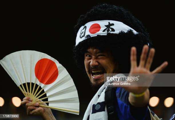 Japan fan enjoys the atmopshere prior to the FIFA Confederations Cup Brazil 2013 Group A match between Italy and Japan at Arena Pernambuco on June 19...