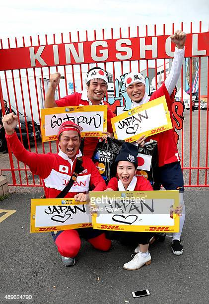 Japan fans pose prior to the 2015 Rugby World Cup Pool B match between Scotland and Japan at Kingsholm Stadium on September 23 2015 in Gloucester...