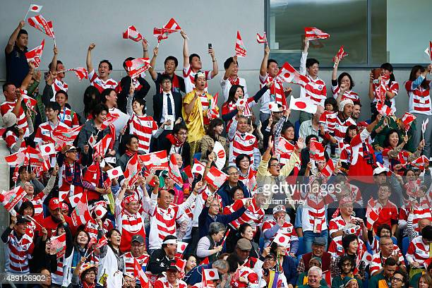 Japan fans support their team during the 2015 Rugby World Cup Pool B match between South Africa and Japan at the Brighton Community Stadium on...