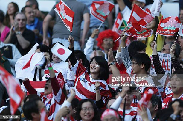 Japan fans support their team during the 2015 Rugby World Cup Pool B match between South Africa and Japan at Brighton Community Stadium on September...