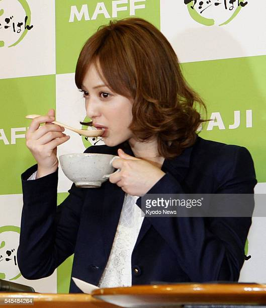 TOKYO Japan Fashion model Nozomi Sasaki eats soup at an event to promote healthy eating at the farm ministry in Tokyo on March 3 2011