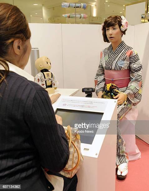OSAKA Japan Female talking robot Minami sells 'yukata' a traditional Japanese garment as a store clerk at the Takashimaya Osaka department store in...