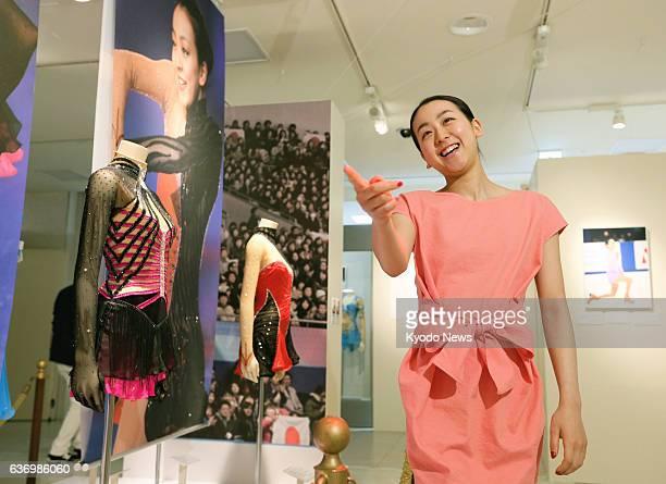 NAGOYA Japan Figure skater Mao Asada visits the venue for an exhibition of photos of herself at JR Nagoya Takashimaya department store in Nagoya on...