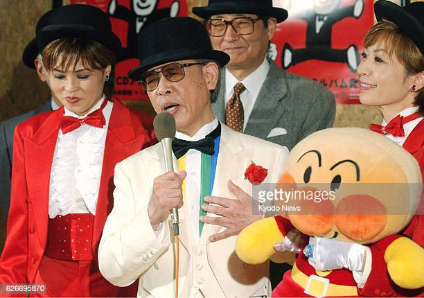 TOKYO Japan File photo shows Japanese cartoonist Takashi Yanase singing at a press conference held for his CD debut as a singer in Tokyo's Bunkyo...