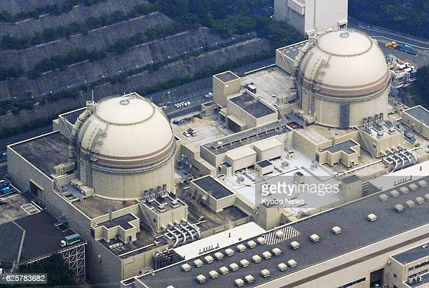 NAGOYA Japan File photo taken in July 2013 shows the No 4 and No 3 reactor buildings at Kansai Electric Power Co's Oi nuclear power plant in the town...