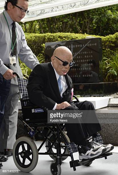 TOKYO Japan File photo taken in June 2013 shows Yuji Kodama a prominent fighter of discrimination against former leprosy patients in a wheelchair in...