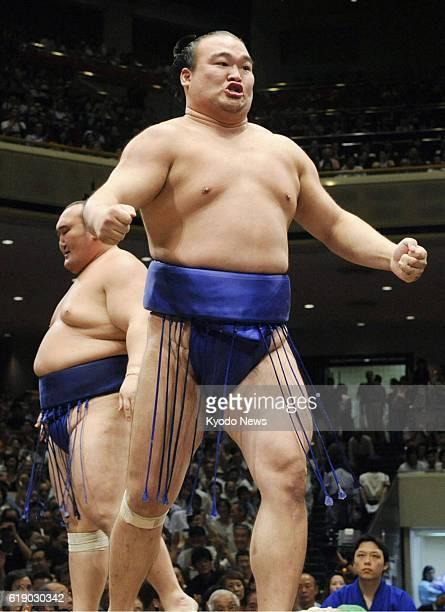 TOKYO Japan File photo taken in September 2007 shows Takamisakakri celebrating after winning a bout at the Autumn Grand Sumo Tournament at Tokyo's...