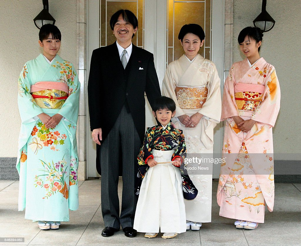 TOKYO, Japan - Five-year-old Prince Hisahito (C) poses with his sister Princess Mako (L), father Prince Akishino (2nd from L), mother Princess Kiko (2nd from R) and sister Princess Kako (R) at the imperial family's shared house in Tokyo's Motoakasaka district on Nov. 3, 2011. The young prince attended ceremonies to celebrate his growth at the house earlier in the day.