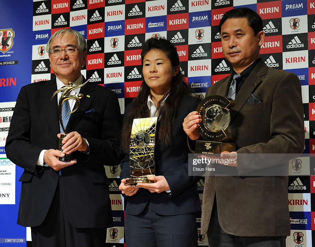 Japan Football Association President Junji Ogura, Women's World Player of the Year <a gi-track='captionPersonalityLinkClicked' href=/galleries/search?phrase=Homare+Sawa&family=editorial&specificpeople=744563 ng-click='$event.stopPropagation()'>Homare Sawa</a> and FIFA World Coach of the Year for Women's Football <a gi-track='captionPersonalityLinkClicked' href=/galleries/search?phrase=Norio+Sasaki+-+Soccer+Coach&family=editorial&specificpeople=5488586 ng-click='$event.stopPropagation()'>Norio Sasaki</a> pose for photographs with their respective trophies during the Ballon d'Or Press Conference at JFA House on January 11, 2012 in Tokyo, Japan.