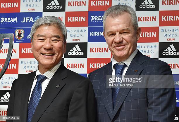 Japan Football Association president Kuniya Daini and Japan's coach Javier Aguirre attend a press conference to announce JFA's 2015 yearround...
