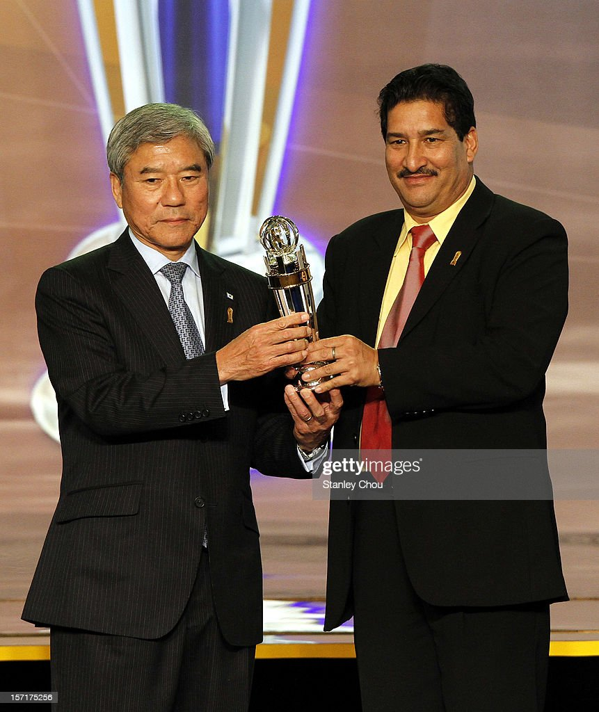 Japan football Association President Kunlya Daini receives the 2012 AFC National Team of the Year Award (Women) from Ganesh Thapa AFC Vice President during the 2012 AFC Annual Awards at the Mandarin Oriental Hotel on November 29, 2012 in Kuala Lumpur, Malaysia.