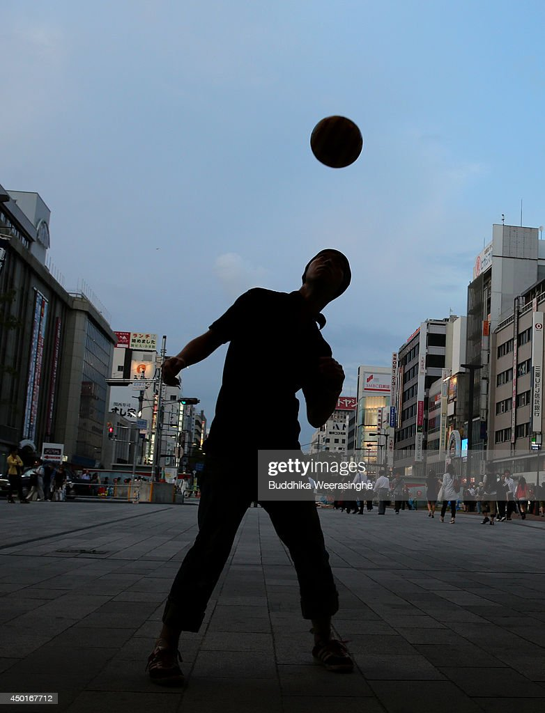 A Japan football fan, Yoshioka Toshifumi, 33, performs free football in front of the Himeji station on June 6,2014 in Himeji, Japan. The 2014 FIFA World Cup kicks off June 12 in Brazil.