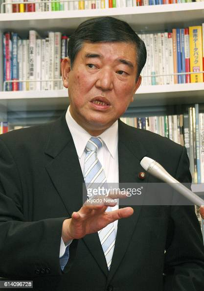 TOKYO Japan Former Defense Minister Shigeru Ishiba answers reporters' questions in Tokyo on Sept 27 after accepting a request by the Liberal...