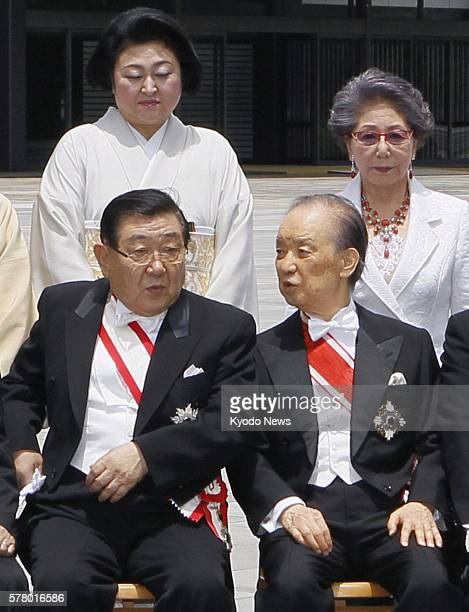 TOKYO Japan Former Japanese Prime Minister Toshiki Kaifu chats with Masatoshi Wakabayashi former agriculture minister during a photo session for the...