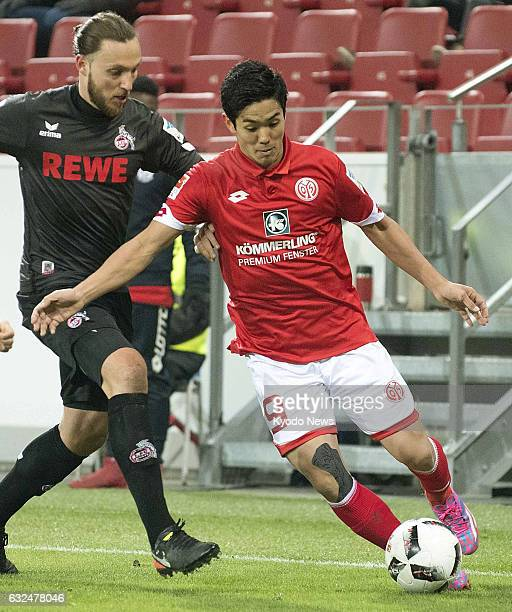 Japan forward Yoshinori Muto vies for the ball during the first half of a German Bundesliga match in Mainz on Jan 22 2017 Muto made his comeback in...
