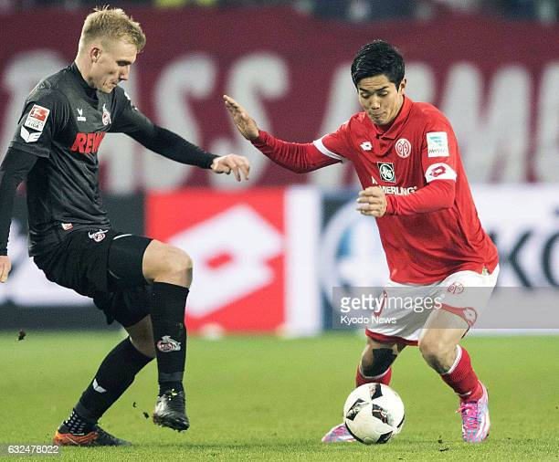 Japan forward Yoshinori Muto vies for the ball during the second half of a German Bundesliga match in Mainz on Jan 22 2017 Muto made his comeback in...