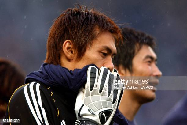 Japan goalkeeper Seigo Narazaki and striker Akinori Nishizawa leave the field after being knocked out of the FIFA 2002 World Cup after losing to...