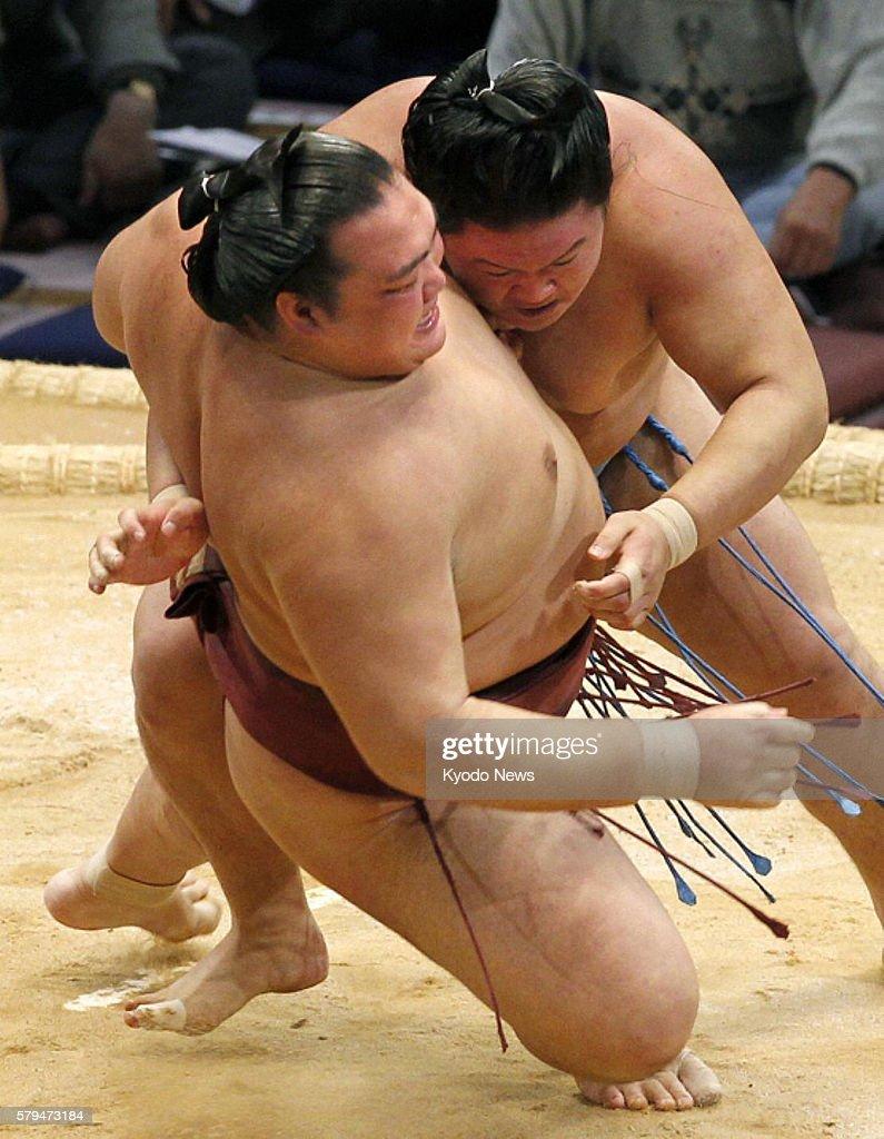 FUKUOKA Japan Goeido takes down ozekihopeful Kisenosato with an outside leg trip at Fukuoka Kokusai Center in Fukuoka southwestern Japan on Nov 17...