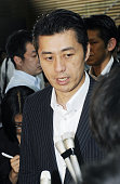 TOKYO Japan Goshi Hosono minister in charge of the nuclear crisis speaks to reporters at the prime minister's office in Tokyo on Aug 12 after a...