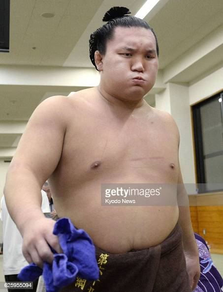 TOKYO Japan Grand champion Hakuho is pictured shortly after being defeated by sekiwake Goeido suffering his first defeat on the 10th day of the...