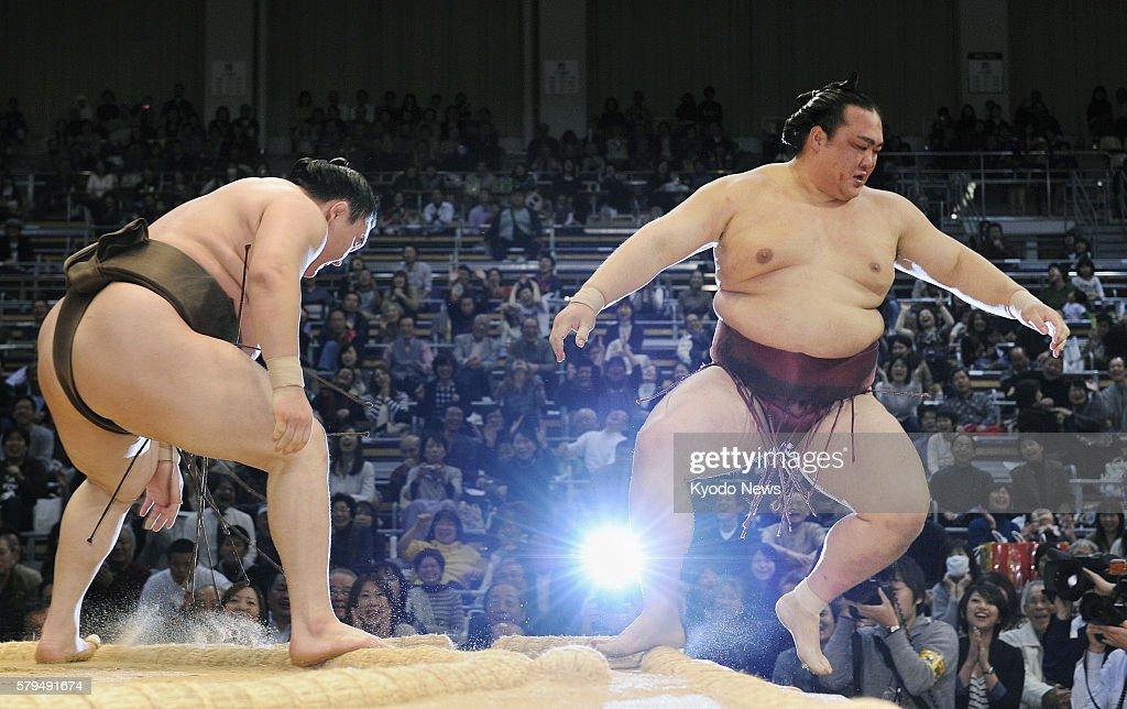 FUKUOKA Japan Grand champion Hakuho overpowers sekiwake Kisenosato at the ring's edge during the Kyushu Grand Sumo Tournament at Fukuoka Kokusai...