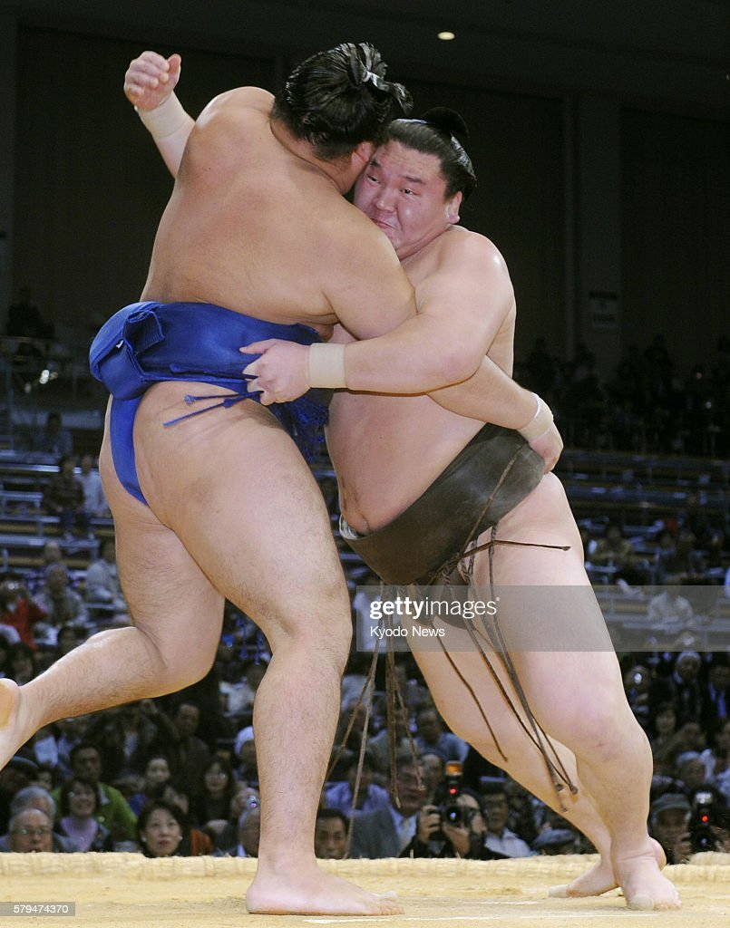 FUKUOKA Japan Grand champion Hakuho wrestles Kakuryu at Fukuoka Kokusai Center in Fukuoka on Nov 22 the 10th day of the Kyushu Grand Sumo Tournament...