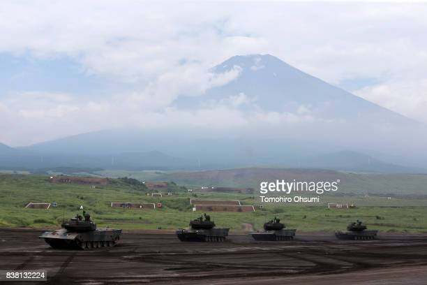 Japan Ground SelfDefense Force battle tanks move during a livefire exercise at the foot of Mount Fuji in the Hataoka district of the East Fuji...