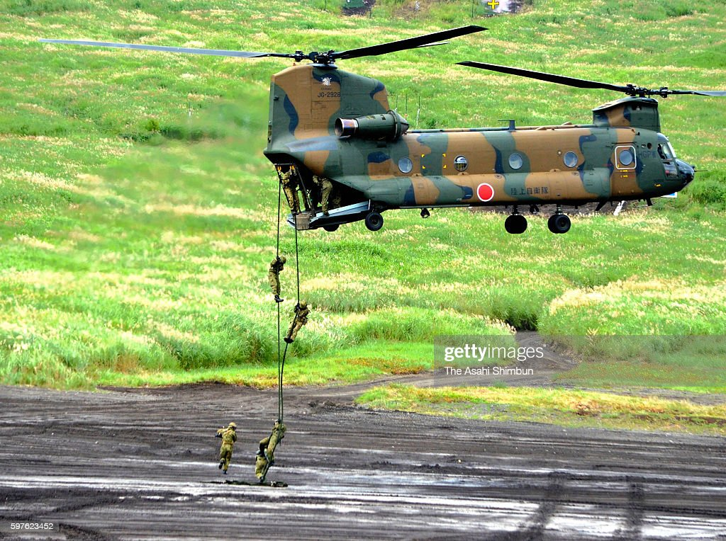 Japan Ground SelfDefense Force members attend a repelling training during the annual live firing exercise at the JGSDF HigashiFuji training range on...
